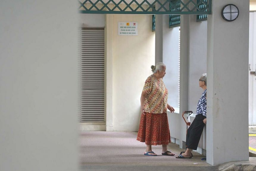 Two elderly woman chatting at a void deck on Dec 17, 2015.