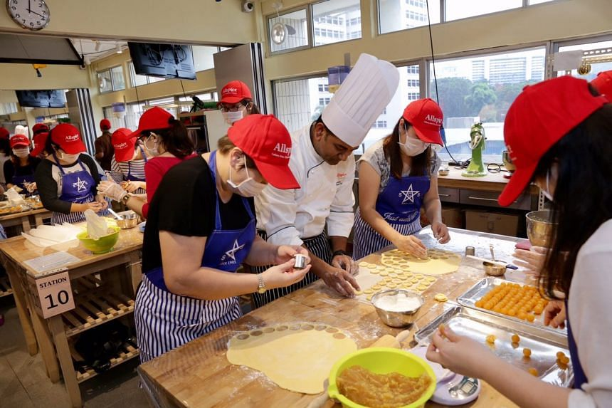 About 80 residents got together on Saturday (Jan 14) for a mass pineapple-tart baking session in a bid to set a local record for the largest Chinese character made with pineapple tarts.