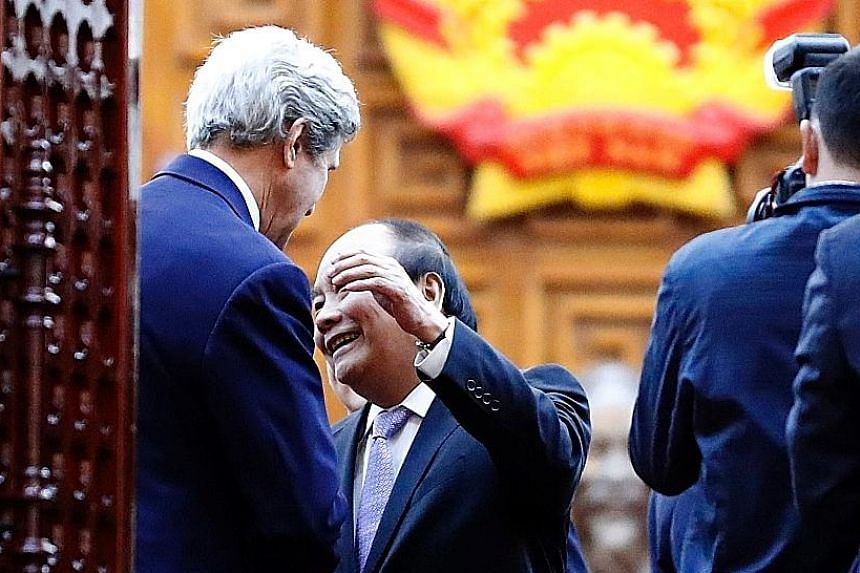 Vietnamese Prime Minister Nguyen Xuan Phuc reaching out to hug US Secretary of State John Kerry after a meeting yesterday.