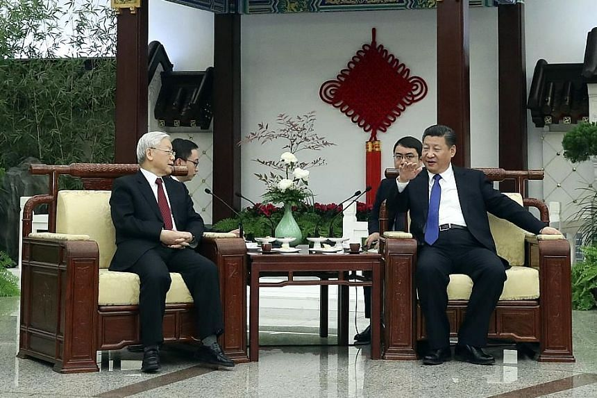 Chinese President Xi Jinping and Vietnamese Communist Party chief Nguyen Phu Trong having tea together in Beijing on Thursday.