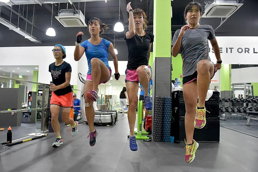 From left: National cyclists Serene Lee, Sarah Tan, Michelle Ho and Jeynelle Lee going through their paces at a training session. The quartet are part of a nine-strong women's cycling squad that will send two members to participate in the SEA Games i