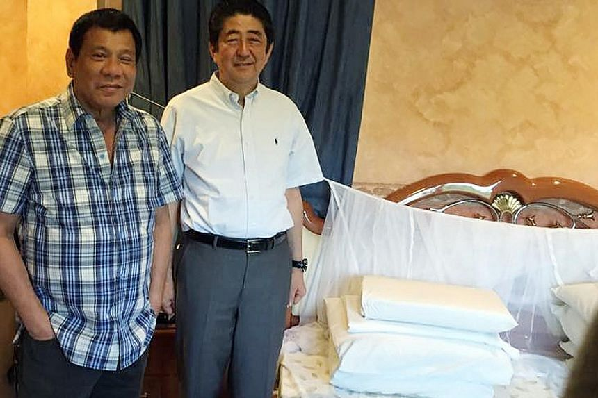 Philippine President Rodrigo Duterte giving Japanese Prime Minister Shinzo Abe a tour of his home in Davao City, including his bedroom, where he showed him his old favourite mosquito net, which he still uses. The two later had breakfast at a small ta