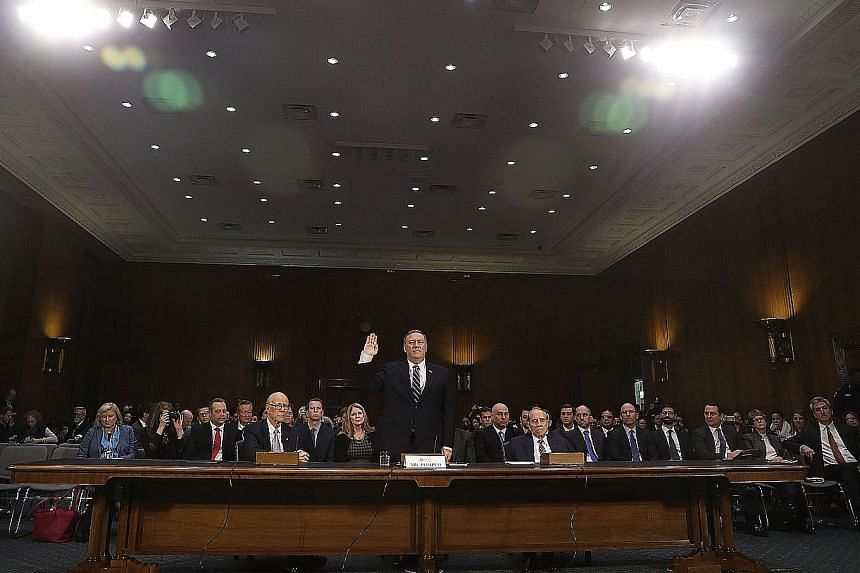 Mr Pompeo being sworn in at his confirmation hearing in Washington on Thursday. His strong stance against Russia could put him at odds with Mr Trump, who has been positive about President Putin.
