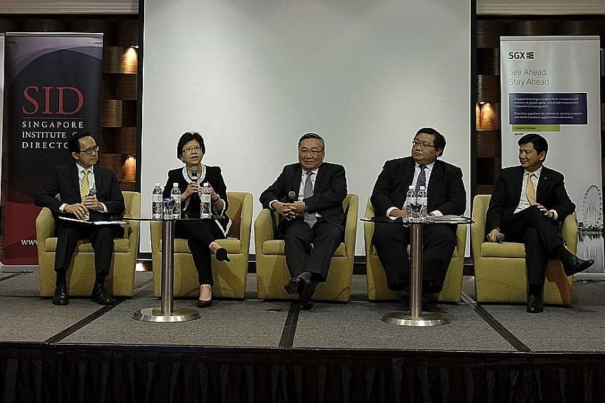 (From left) Singapore Institute of Directors vice-chairman Daniel Ee, DBS chief financial officer Chng Sok Hui, Keppel Corp audit committee chairman Danny Teoh, Acra CEO Kenneth Yap and PwC Singapore executive chairman Yeoh Oon Jin at the Audit Commi