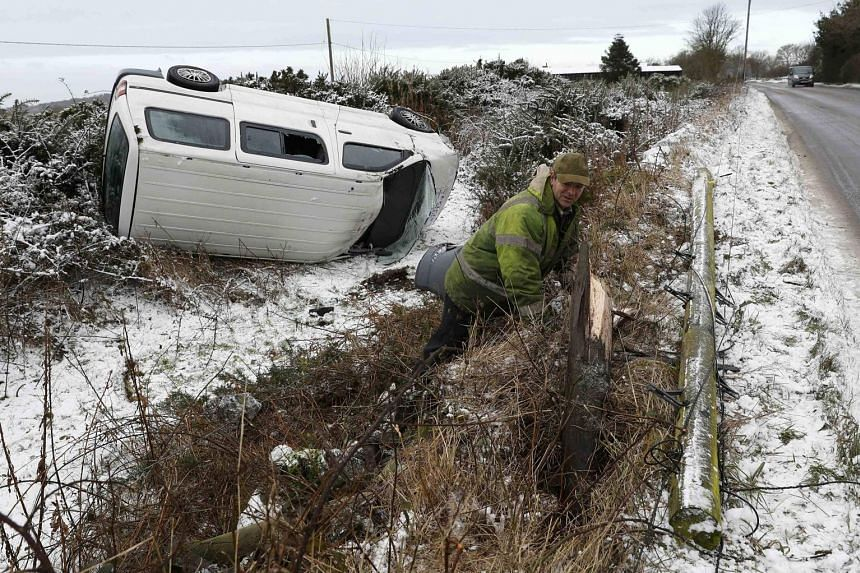 An accident caused by icy conditions near the town of Coalville in England. Since the end of last week, a winter cold snap across Europe has killed more than 60 people, with homeless people and migrants stranded in countries such as Greece and Serbia