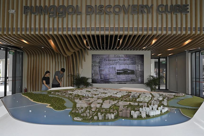 A wall (right) on the second floor of Punggol Discovery Cube provides information on the development of the town over the years. Visitors can also check out an interactive model of the estate (below) at the three-storey centre, located near Punggol M