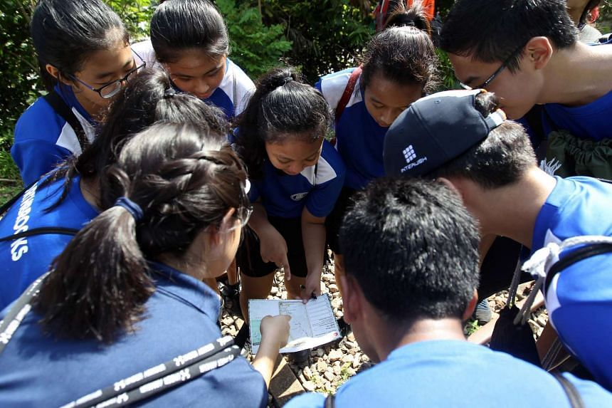 Students from Northbrooks Secondary School navigating to their next checkpoint with a map.