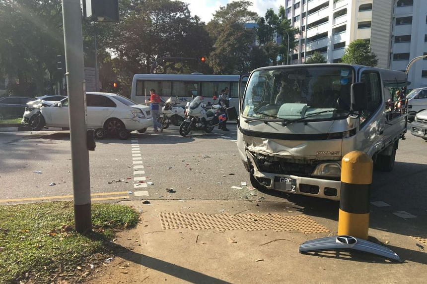 Eleven people were taken to hospital after a collision between a Mercedes and a lorry in Yishun.