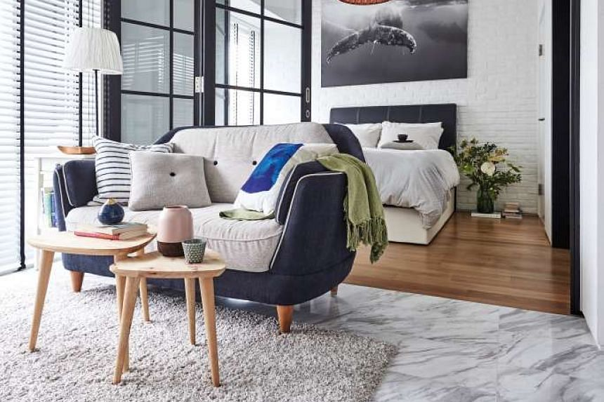 To add a pop of colour to the living room, the owner customised a blue linen sofa  from Courts by adding white piping, a removable back cushion and buttons.