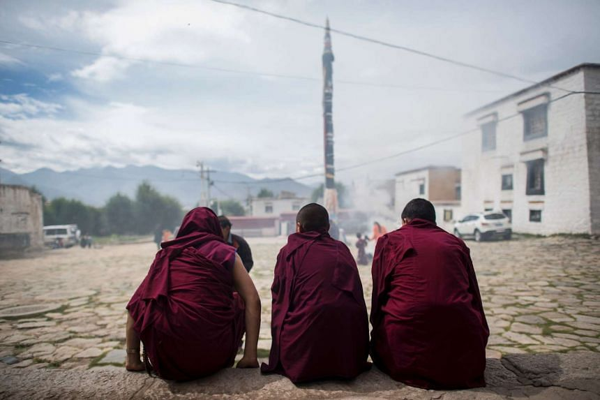 Young monks sit in front of the Buddhist Sera monastery in the regional capital Lhasa, in China's Tibet Autonomous Region. Xinhua reported that China has appointed a new governor for Tibet.