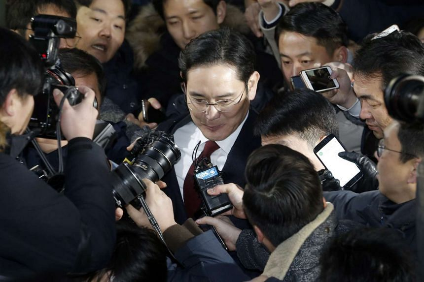 Lee Jae Yong (centre), Vice-Chairman of Samsung Electronics, leaves the special prosecutor's office in Seoul, South Korea on Jan 13, 2017.