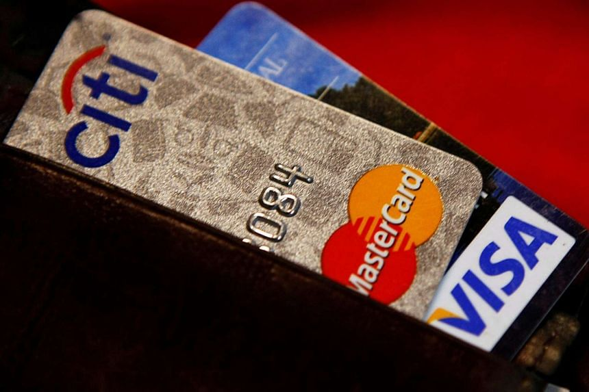 Credit cards are pictured in a wallet in Washington on Feb 21, 2010.
