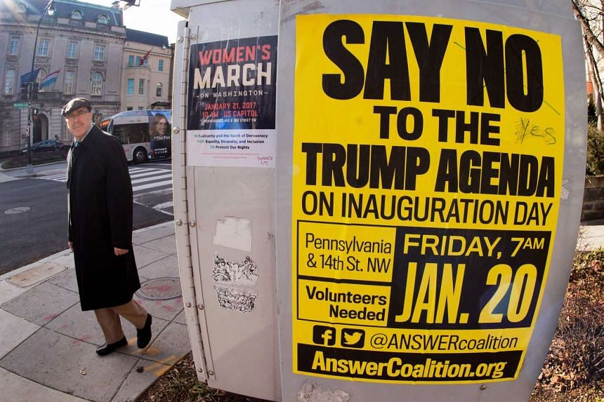Street posters calling for protests are seen Jan 13, 2017, in the Dupont Circle area of Washington, a week before the Inauguration of Donald Trump as US president.