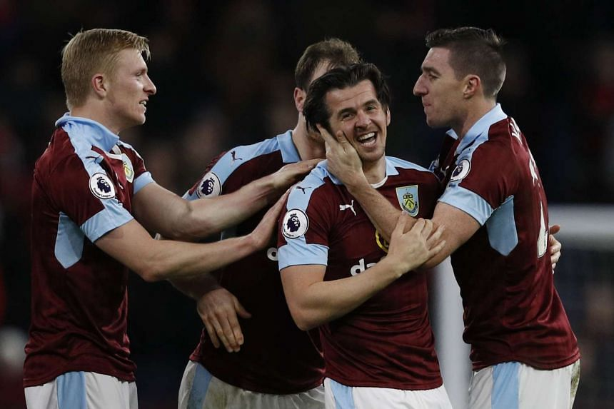 Burnley's Joey Barton celebrates scoring with team mates.