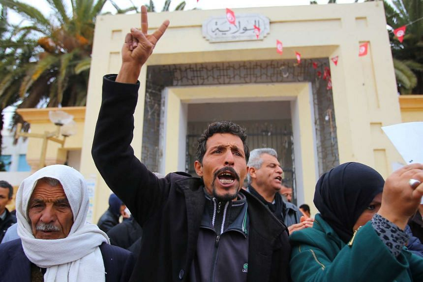 Unemployed Tunisians shout slogans during a demonstration demanding the government provide them with job opportunities in Sidi Bouzid, Tunisia, Jan 14, 2017.