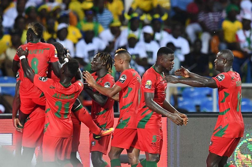 Guinea-Bissau's players celebrate after scoring a goal.