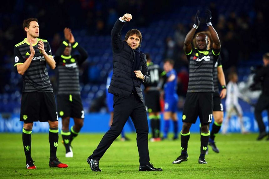 Chelsea's manager Antonio Conte (centre) celebrates after the match.