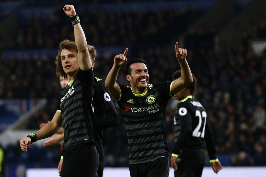 Chelsea's Spanish midfielder Pedro (2nd R) celebrates with teammates after scoring their third goal.