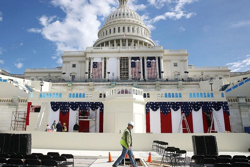 Work is ongoing at the stage ahead of Friday's inauguration at the US Capitol, where Mr Trump and Mr Pence will be sworn in.