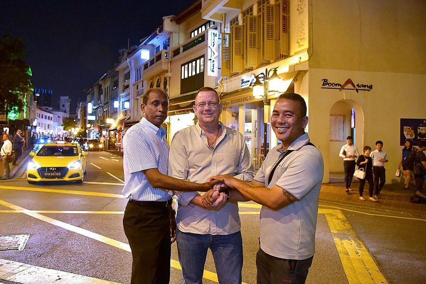 Mr Corneliussen flanked by Mr Ayub (left) and Mr Roslan. The grateful Norwegian last week finally got to thank the two men who helped clear his name in an incident involving a cabbie in 2014.