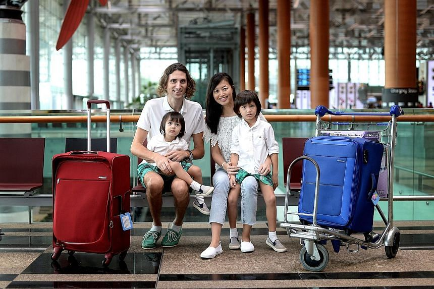 Get.com founders Pedro Pla and Grace Cheng with their children Ramses, four, and Ranefer, two. They set off today on a six-month trip using round-the-world business class tickets with SIA redeemed from 960,000 miles - all from the couple's credit car