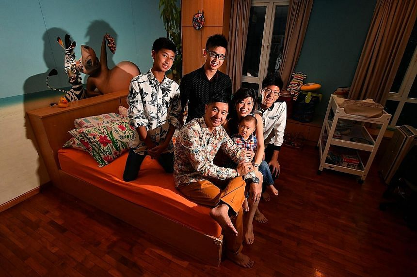 Mr Freddy Sim and his wife Viviena with their sons (clockwise from left) Euan, 14, a Secondary 2 student at ACS Barker, Eugene, 21, a Year 3 student studying computer engineering at Ngee Ann Polytechnic, Ethan, 15, a Secondary 3 student at ACS Barker