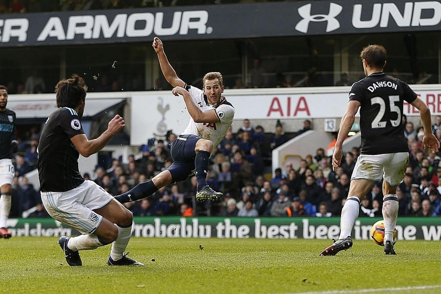 Tottenham's Harry Kane scoring his team's third goal against West Brom at White Hart Lane yesterday. He finished with a hat-trick in a 4-0 Premier League thumping of the visitors.