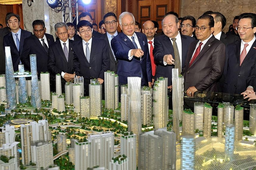 PM Najib Razak and Chinese Ambassador to Malaysia Huang Huikang (right) looking at a model of the Bandar Malaysia project last year. Former deputy PM Muhyiddin Yassin, in criticising China, has said that many Malaysians would not feel comfortable see