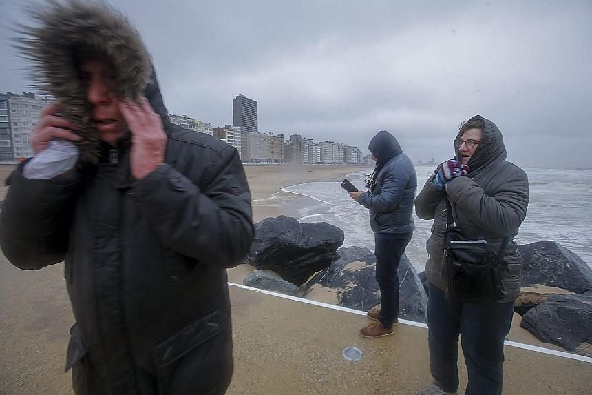 People braving the stormy weather along the seafront in Oostende, Belgium, last Friday. The same storm, officially named Egon, has also battered Germany. A refugee camp on Lesvos island in Greece. The cold snap across Europe has killed more than 60 p
