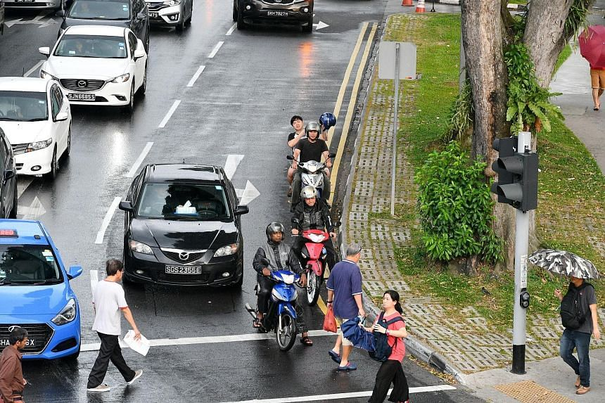 Motorcyclists along Admiralty Road riding towards Woodlands Town Centre last week.