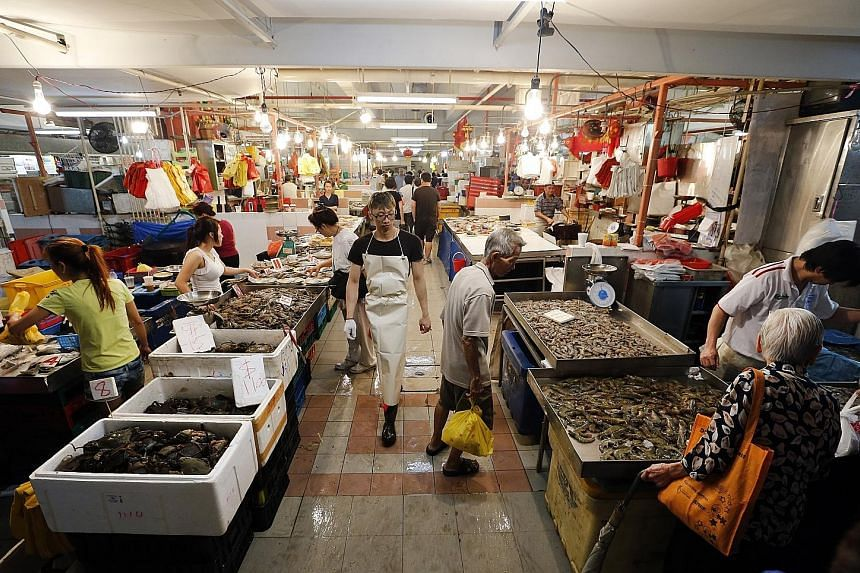 A check at several wet markets, such as this market in Chinatown, showed that prices of fish, such as pomfret and red grouper, have increased by 30 to 50 per cent compared with about three weeks ago. Large prawns also now cost $35 per kg, up from $28