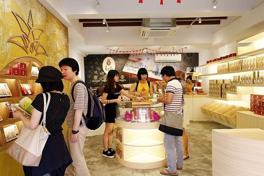 Prices of Chinese New Year goodies such as pineapple tarts, shrimp rolls and love letters are mostly the same as last year's.
