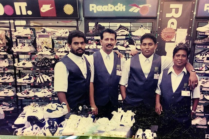 Mustafa retail supervisor P. Mohamed Rafeek (left) with his colleagues from the sportswear section at the Serangoon Plaza store in 1996. Beside him is Mr Abdul Rahman, 47, now a supervisor at the supermarket section in Mustafa Centre. The other two m
