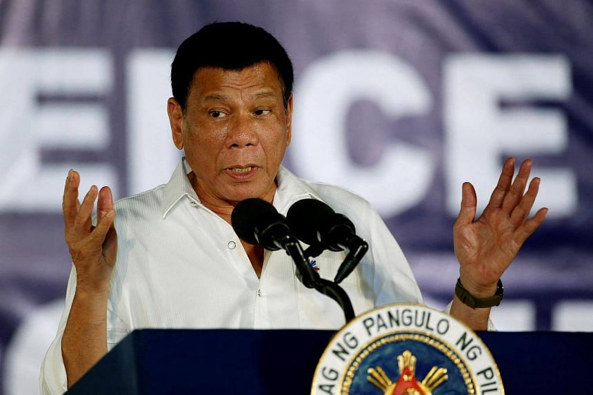 Philippines' President Rodrigo Duterte speaking in front of housewives and mothers, that participate in the anti-illegal drugs campaign of the provincial government and Duterte's war on drugs, on Dec 22, 2016.
