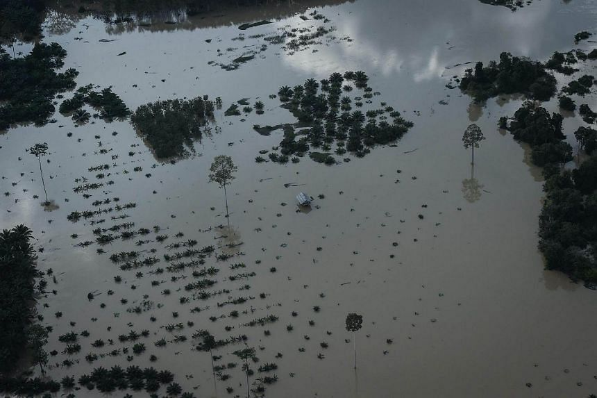 An aerial view of a house surrounded by floodwaters in Thailand's southern province of Surat Thani on Jan 11, 2017.