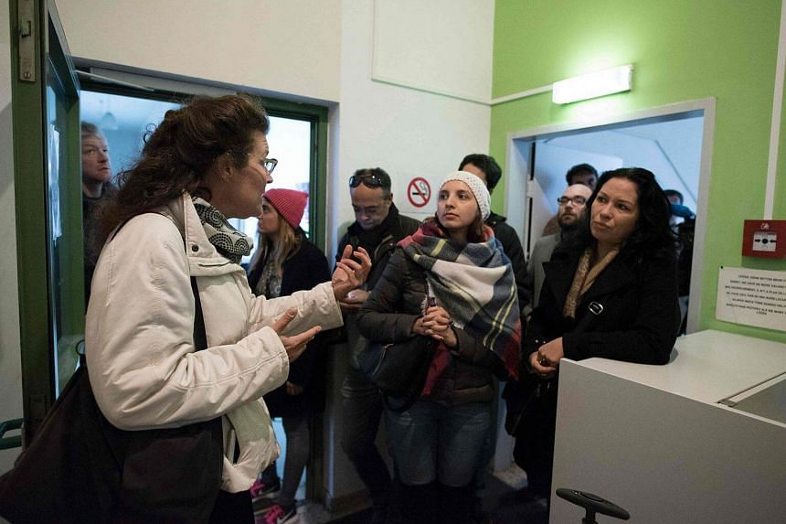 Homeless tour guide Barbara talking to tourists at one of the shelters for homeless people in Vienna, Austria, on Oct 30, 2016.