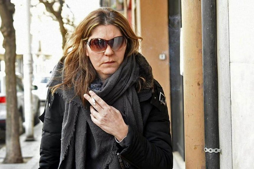 Marga Garau, the wife of Fernando Blanco who was arrested for a scam using his young daughter's rare disease, leaves the Seu d'Urgell court in Lleida, northeastern Spain, on Jan 13, 2017.