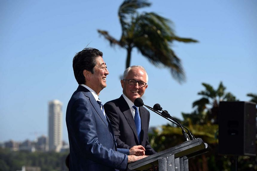 Mr Turnbull and Mr Abe at a joint press conference at Kirribilli House in Sydney yesterday. Mr Abe is in the middle of a whirlwind four-nation tour - including the Philippines, Indonesia and Vietnam - to boost Japan's economic and security ties acros