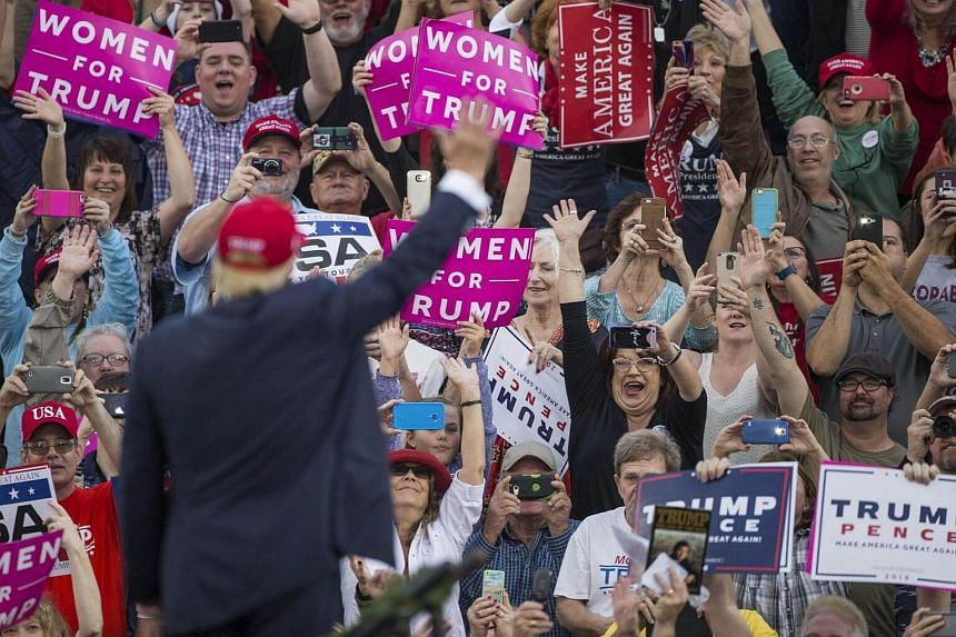 Supporters waving as president-elect Donald Trump arrives for a thank you rally in Ladd-Peebles Stadium on Dec 17, 2016, in Mobile, Alabama.