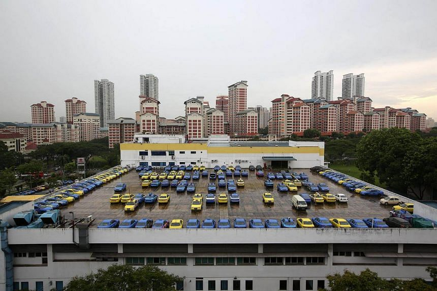 Taxis parked at the CityCab Building in Sin Ming Avenue, on June 22, 2016.