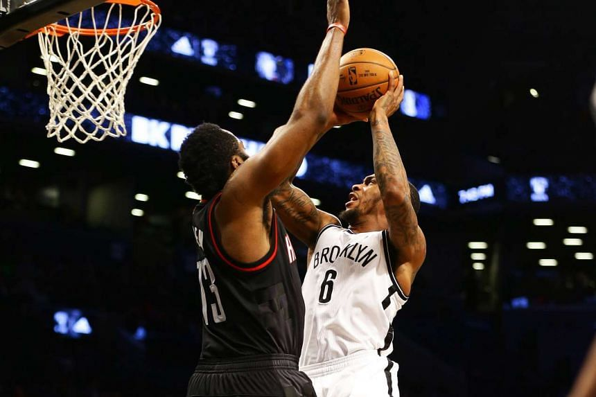 Brooklyn Nets guard Sean Kilpatrick (6) goes up for a shot against Houston Rockets guard James Harden (13) during the second half of their game on Jan 15, 2017.