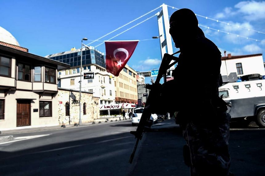 A Turkish special force police officer standing guard at Ortakoy district near the Reina night club, in Istanbul on Jan 2, 2017.