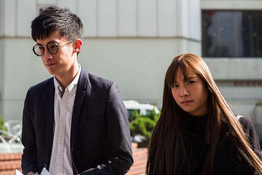 Pro-independence lawmakers Baggio Leung (left) and Yau Wai-ching arrive to speak to the press outside the High Court in Hong Kong on Nov 30, 2016.
