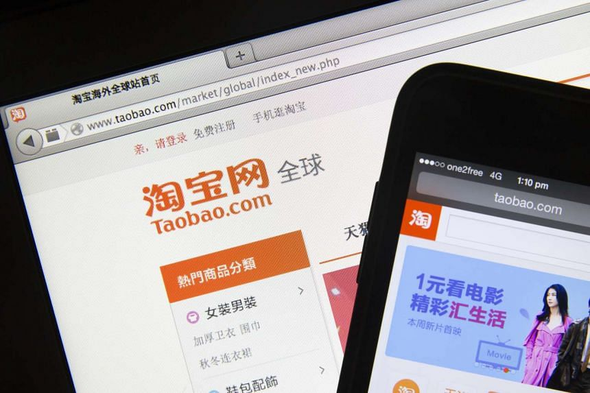 Taobao, a website of Alibaba Group Holding Ltd, is displayed on an Apple Inc. MacBook Air laptop (left), and iPhone 5c in Hong Kong, China, on Mar 21, 2014.