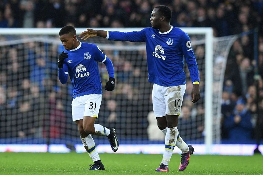 Everton's Belgian striker Romelu Lukaku (right) congratulates Everton's English striker Ademola Lookman on scoring his debut goal during the English Premier League football match at Goodison Park in Liverpool on Jan 15, 2017.