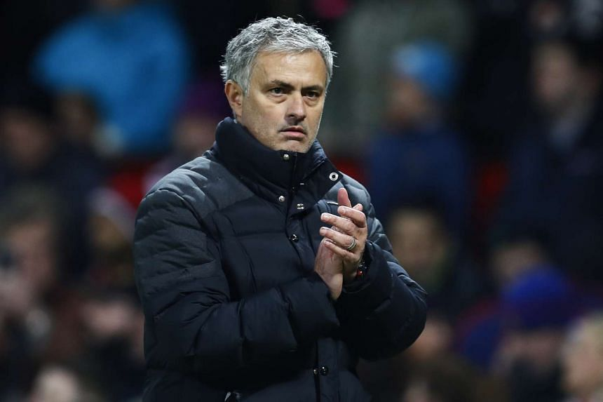 Manchester United manager Jose Mourinho applauds fans after the game.
