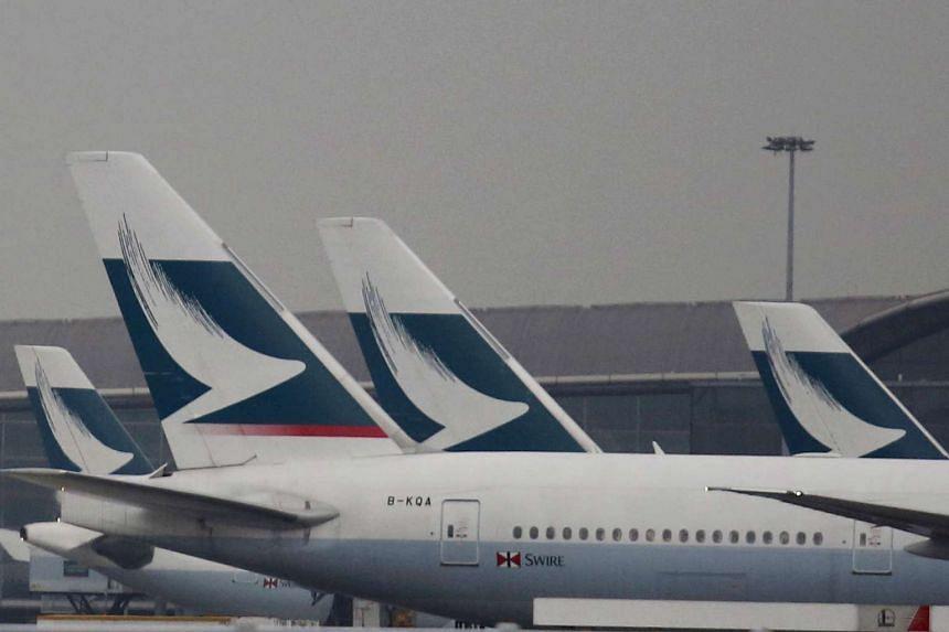 Passenger planes of Cathay Pacific Airways park at the Hong Kong Airport terminal in Hong Kong, China on March 7, 2016.