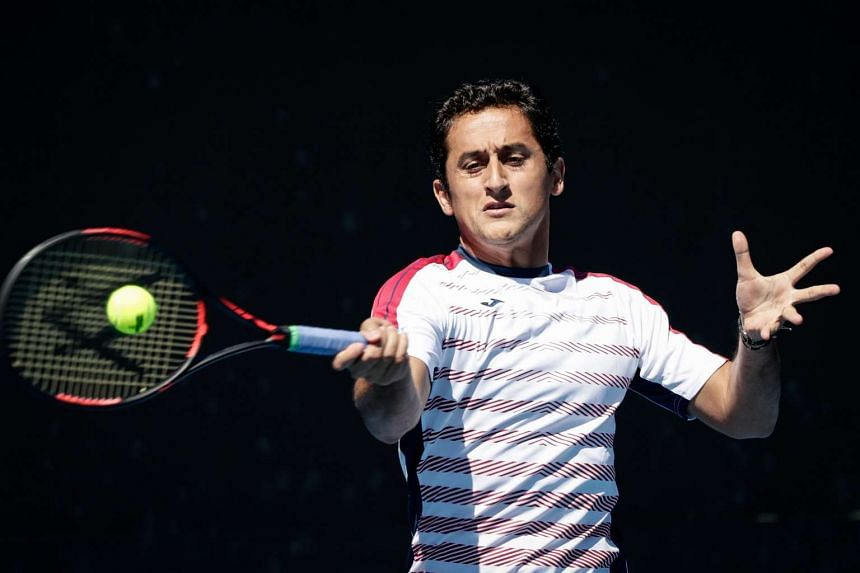 Nicolas Almagro in action against Jeremy Chardy (not pictured) during their first round match at the Australian Open Grand Slam tennis tournament in Melbourne, on Jan 16, 2017.