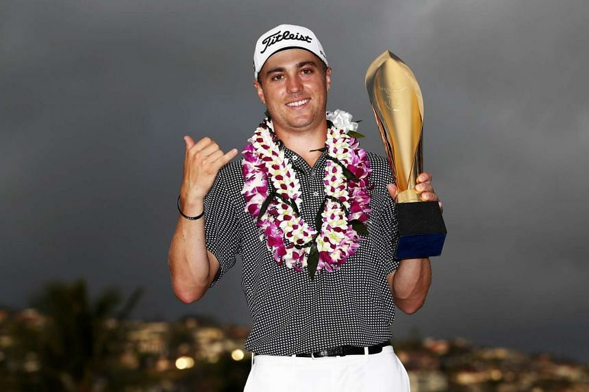 Justin Thomas of the United States celebrates with the trophy after winning the Sony Open In Hawaii at Waialae Country Club on Jan 15, 2017, in Honolulu, Hawaii.