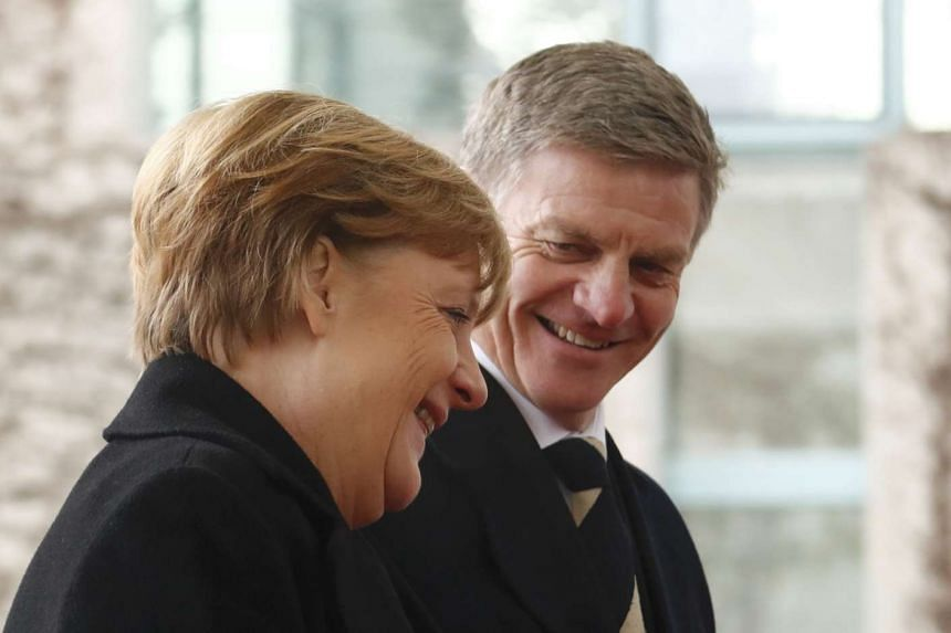 German Chancellor Angela Merkel welcomes New Zealand Prime Minister Bill English at the chancellery in Berlin, Germany, Jan 16, 2017.